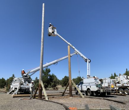 CEC line crews place brand new poles at the Oregon Youth Challenge Program Obstacle Course.