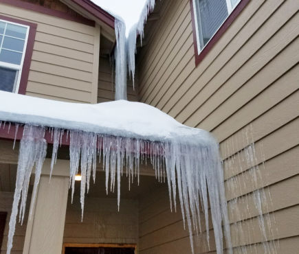 Two ice dams form on a residential home