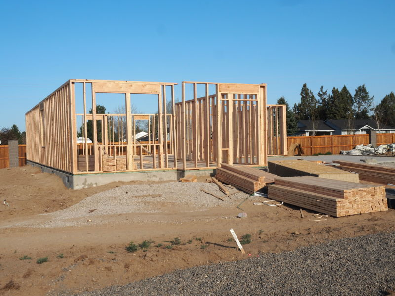 A home site under construction with basic framing in place.