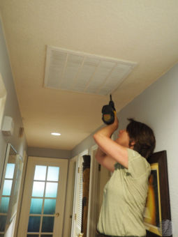 A homeowner replaces her air filter